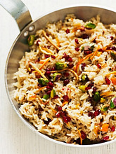 Pilau rice with pistachio nuts, pomegranate seeds and orange zest