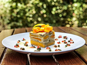A slice of pumpkin lasagne on a garden table