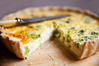 Cheddar and leek quiche, sliced