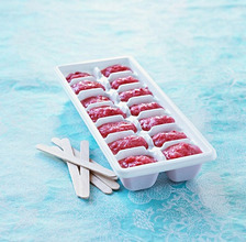 Homemade ice lollies in an ice cube tray