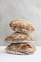 A stack of three loaves of sour dough bread