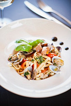 Tagliatelle con le vongole e la bottarga (pasta with clams and fish roe, Italy)