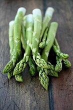 Green asparagus on a wooden table