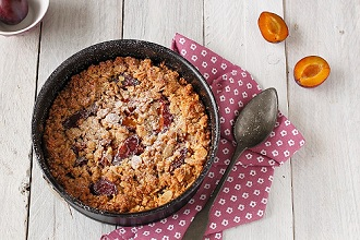 Plum crumble in baking dish