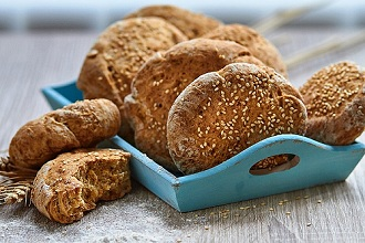 Sesame seed rolls on a wooden board