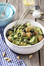 Potato salad with new potatoes, courgettes, olives, almonds and pesto