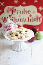 Vanilla crescent biscuits on a white cake stand