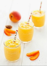 Glasses of apricot and mango smoothies