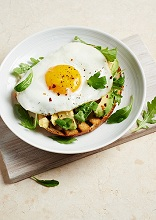 A fried egg and avocado on toast