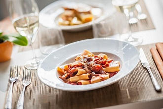 Paccheri all'amatriciana (pasta with bacon and chillis, Italy)