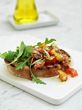 Bruschetta with tomatoes and rocket
