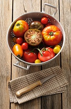 Various types of tomatoes in a colander
