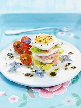 A stack of lettuce, ham and hard-boiled egg