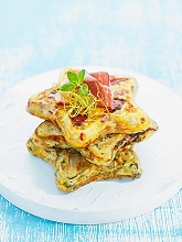 Star-shaped Spanish omelettes with dry-cured ham, stacked