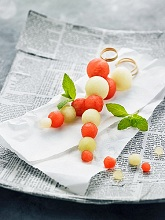 Melon skewers on a paper napkin