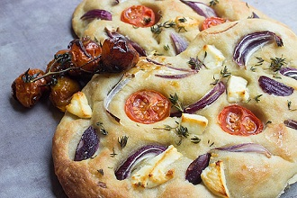 Focaccia with tomatoes, onions and cheese