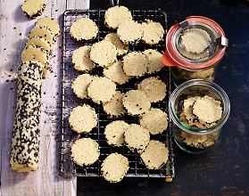 Sesame seed biscuits (baked and raw on a wire rack)