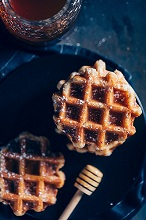 Waffles in a grid with icing sugarand honey