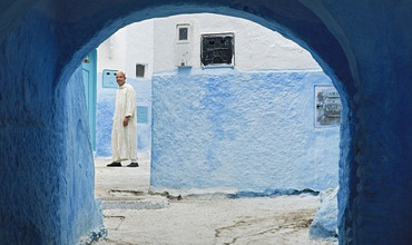 Man in traditional Moroccan clothes walking in the street, Chefchaouen, Morocco, North Africa, Africa