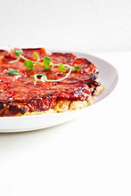 Tomato Tatin on a White Plate