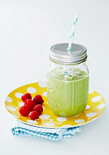 A green smoothie with raspberries