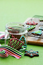Decorated Christmas biscuits in a jar and on a wire rack