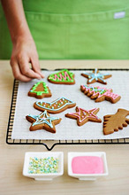 Christmas biscuits being decorated