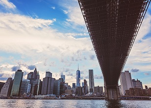 Brooklyn Bridge over Hudson River with financial district in background,  New York City, New York, USA