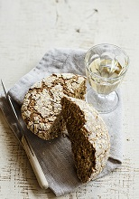 Bread with oatmeal and glass of white wine, Italy