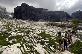Excursionists on 316 path from Stoppani hut (2437m) to Tuckett hut (2272m), Castello di Vallesinella, Dolomiti di Brenta chain, Trentino Alto Adige, Italy