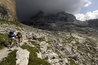 Excursionists, Tuckett and Sella huts (2272m), Punta Massari and Punta Campiglio tops, Dolomiti di Brenta, Trentino Alto Adige, Italy