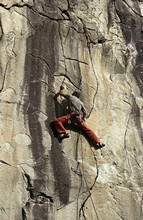 Man climbing up a rock way called Rebel, difficulty 7c, length 20m, Parete delle ninfe, Montebracco, Sanfront, Cuneo, Piedmont, Italy, Europe