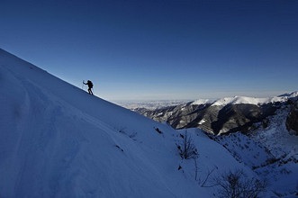 Ski-alpinist on a snow ridge, Chiusa Pesio, Pesio Valley, Cuneo, Piedmont, Italy, Europe