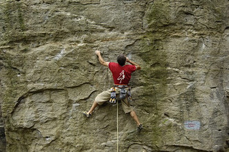 Man climbing up a rock way called Gli indovinotteri, difficulty 6c+, Lungaserra, Montebracco, Barge, Cuneo, Piedmont, Italy, Europe