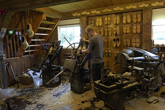 Craftsman prepares traditional clogs, Zaandam, Netherlands, Europe