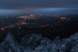 Landscape view from Mount Subasio the Umbrian valley, at night where we can see the lights of the city of Assisi, Perugia, Umbria, Italy, Europe