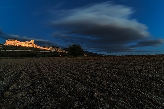 Cityscape at dusk from countryside, Assisi, Umbria, Italy, Europe
