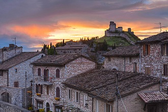 Cityscape of historical center and in background the Rocca Maggiore castle, Assisi, Umbria, Italy, Europe