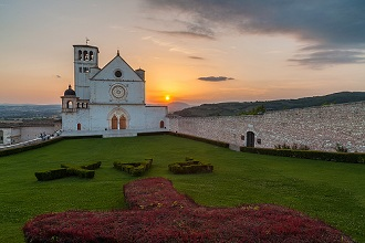 St. Francis Basilica at sunset with special garden adjacent to the Church, Assisi, Umbria, Italy, Europe