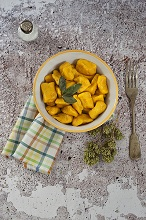 Pumpkin gnocchi and potatoes seasoned with butter and sage