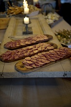 Italian salami cut into slices on a wooden board
