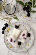 Blackberry ice lollies in a dish, Italy, Europe