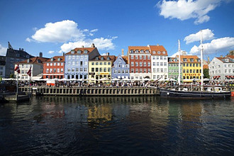 Old houses, boats and Cafes along the Nyhavn Canal, Copenhagen, Denmark, Europe