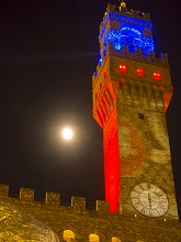 Italy, Tuscany, Florence at christmas time. The Arnolfo tower and moon, the tower of Palazzo Vecchio