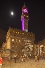 Italy, Tuscany, Florence at christmas time. The Palazzo Vecchio and moon and Signoria square.