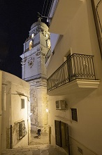 Walking at night through the alleys of the historic center of Vieste, Apulia, Italy, Europe
