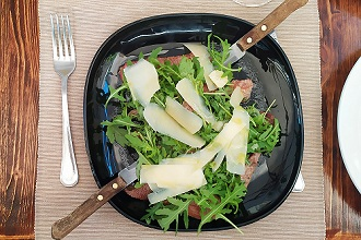 Beef carpaccio with rocket and parmesan flakes, Italy, Europe