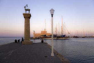 Antelopes on columns at entrance to Mandraki harbor, Rhodes, Dodecanese, Greek Islands, Greece, Europe