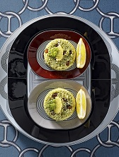 Cous cous burgers with raisins and lemon flavoured avocado, Sicily, Italy, Europe