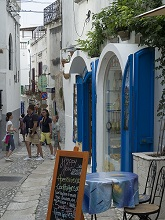 shops and people at the old town of Peschici, Puglia, Italy, Europe